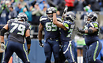 Seattle Seahawks defensive tackle Clinton McDonald, left, is congratulated by defensive end Michael Bennett, center,  Red Bryant, , left, and Brandon Mebane, right,  after sacking Jacksonville Jaguars quarterback Chad Henne during at CenturyLink Field in Seattle, Washington on September 22, 2013.   Seahawks beat the Jaguars 45-17. ©2013. Jim Bryant Photo. ALL RIGHTS RESERVED.
