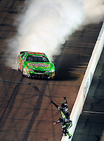 Apr 11, 2008; Avondale, AZ, USA; NASCAR Nationwide Series driver Kyle Busch celebrates after winning the Bashas Supermarkets 200 at the Phoenix International Raceway. Mandatory Credit: Mark J. Rebilas-
