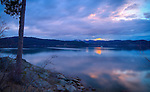 Idaho, North, Idaho Panhandle, Kootenai County, Coeur d'Alene. A view of Lake Coeur d'Alene with reflections at sunset from Tubbs Hill.