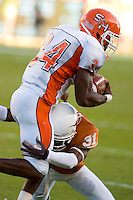 30 September 2006: Sam Houston State back D.D. Terry (#34) is tackled by Texas defender Aaron Ross during the Bearkats 56-3 loss to the University of Texas Longhorns at Darrell K Royal Memorial Stadium in Austin, TX.