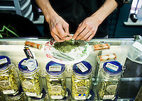 Eric Farthing (cq) rolls joints at the Medicine Man grow house in Denver, Colorado, Tuesday, March 5, 2013. With Colorado's Amendment 64, the state has been working to decide how it will transition to legalized marijuana in the state...Photo by Matt Nager