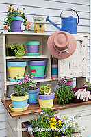 63821-201.19 Potting bench with containers and flowers in spring, Marion Co. IL