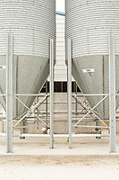 Feed silos attached to a hog barn at a farm run by Thomas King, his son Gage and wife Sharon, where they raise hogs for Smithfield Foods, Inc near Wallace, NC Tuesday, May 15, 2018. (Justin Cook for The Guardian)