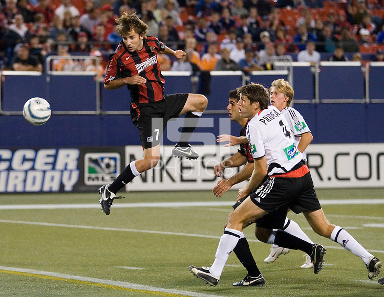 The MetroStars' Mike Magee heads in the only goal of the first half during an MLS game between the MetroStars and D. C. United at Giant's Stadium, East Rutherford, NJ, on October 1, 2005.