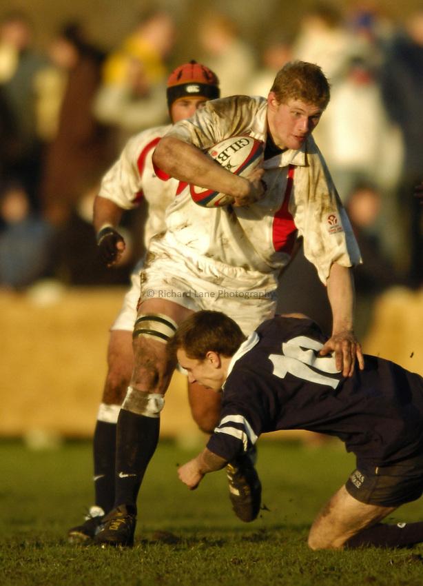 Photo. Jed Wee..England U19 v Scotland U19, U19 Six Nations Championship, Woodlands Stadium, Lytham St Annes. 16/01/2004..England's Chris Goodman (L), with Scotland's David Blair.