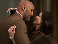 Skyscraper (2018) <br /> Will (DWAYNE JOHNSON) and Dr. Sarah Sawyer (NEVE CAMPBELL)<br /> *Filmstill - Editorial Use Only*<br /> CAP/FB<br /> Image supplied by Capital Pictures