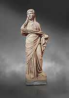 Roman statue of women. Perge. 2nd century AD. inv 3270 . Antalya Archaeology Museum; Turkey. Against a grey background