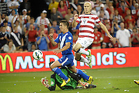 U.S midfielder Michaell Bradley (4) scores the third goal..USMNT defeated Guatemala 3-1 in World Cup qualifying play at LIVESTRONG Sporting Park, Kansas City, KS.