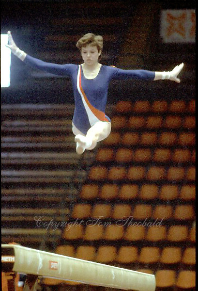 Maxi Gnauck of East Germany performs split leap on balance beam at 1985 European Championships in women's artistic gymnastics at Helsinki, Finland in late April, 1985.  Photo by Tom Theobald.