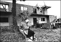Needling outside the destroyed home, Balkan War in Croatia, 1993