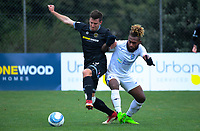 Ross Allen (left) tries to hold off Andrew Rarangia during the 2019 OFC Champions League quarter final football match between Team Wellington and Henderson Eels at David Farrington Park in Wellington on Sunday, 7 April 2019. Photo: Dave Lintott / lintottphoto.co.nz