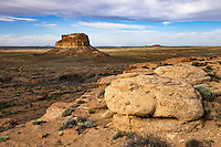 """The 380 foot tall Fajada Butte rises above the valley floor in Chaco Culture National Historic Park. The ruins of about two dozen dwellings have been found in the higher cliff bands, which can be reached now only with rock-climbing gear or via a steep 40-foot """"chimney'' cutting through sandstone rock."""