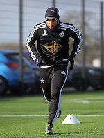 SWANSEA, WALES - JANUARY 28: Ashley Williams warms up during the Swansea City Training Session on January 28, 2016 in Swansea, Wales.