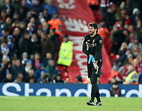 30th November 2019; Anfield, Liverpool, Merseyside, England; English Premier League Football, Liverpool versus Brighton and Hove Albion; Liverpool goalkeeper Alisson pulls off his gloves as he walks from the pitch after being shown a red card   - Strictly Editorial Use Only. No use with unauthorized audio, video, data, fixture lists, club/league logos or 'live' services. Online in-match use limited to 120 images, no video emulation. No use in betting, games or single club/league/player publications