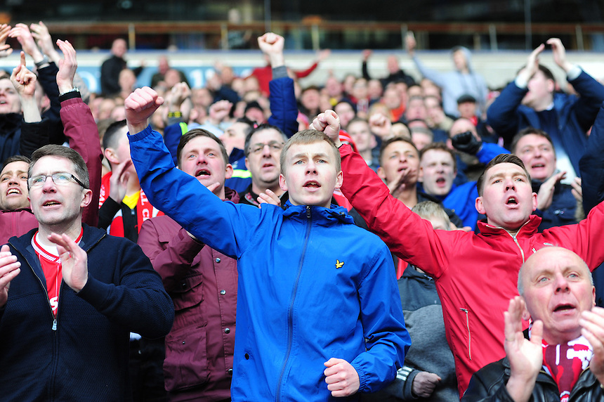 Middlesbrough fans celebrate after Jordan Rhodes had scored their sides winning goal in injury time<br /> <br /> Photographer Chris Vaughan/CameraSport<br /> <br /> Football - The Football League Sky Bet Championship - Bolton Wanderers v Middlesbrough - Saturday 16th April 2016 - Macron Stadium - Bolton<br /> <br /> &copy; CameraSport - 43 Linden Ave. Countesthorpe. Leicester. England. LE8 5PG - Tel: +44 (0) 116 277 4147 - admin@camerasport.com - www.camerasport.com