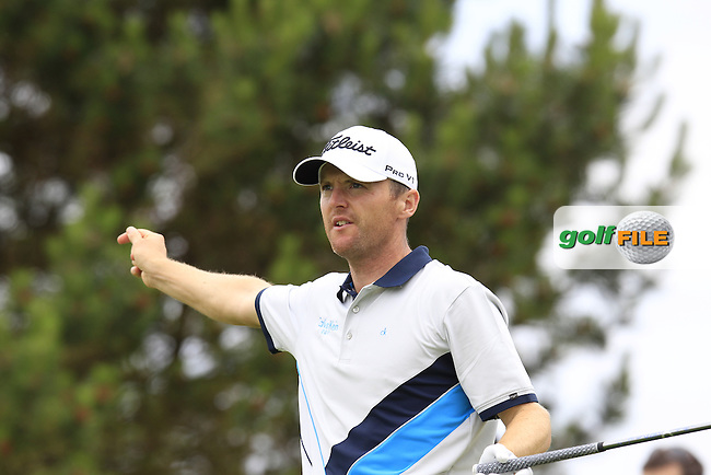 Michael Hoey (NIR) tees off the 15th tee during Sunday's Final Round of the 2014 Irish Open held at Fota Island Resort, Cork, Ireland. 22nd June 2014.<br /> Picture: Eoin Clarke www.golffile.ie