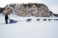 Hugh Neff runs down the Yukon River along the cliffs in third place shortly after leaving the village checkpoint of Ruby in Interior Alaska during the 2010 Iditarod