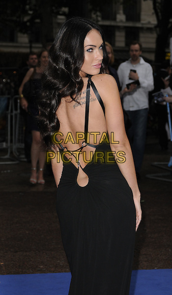 MEGAN FOX.'Transformers: Revenge of the Fallen' .UK film premiere at Odeon cinema, Leicester Square, London, England..15th June 2009.2 two half length black dress backless tattoos straps looking over shoulder.CAP/CAN.©Can Nguyen/Capital Pictures.