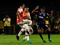BOGOTA - COLOMBIA - 07 - 05 - 2017: Yeison Murillo (Izq.) y Danis Stracqualursi (Cent.) jugadores de Independiente Santa Fe, disputan el balón con Enrique Serje (Der.) jugador de Atletico Junior, durante partido de la fecha 16 entre Independiente Santa Fe y Atletico Junior, por la Liga Aguila I-2017, en el estadio Nemesio Camacho El Campin de la ciudad de Bogota. / Yeison Murillo (L) and Danis Stracqualursi (C) players of Independiente Santa Fe struggle for the ball with Enrique Serje (R) player of Atletico Junior, during a match of the date 16th between Independiente Santa Fe and Atletico Junior, for the Liga Aguila I -2017 at the Nemesio Camacho El Campin Stadium in Bogota city, Photo: VizzorImage / Luis Ramirez / Staff.