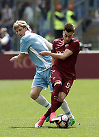 Calcio, Serie A: Roma, stadio Olimpico, 30 aprile 2017.<br /> AS Roma's Stephan El Shaarawy (r) in action with Lazio's Dusan Basta (l) during the Italian Serie A football match between AS Roma an Lazio at Rome's Olympic stadium, April 30 2017.<br /> UPDATE IMAGES PRESS/Isabella Bonotto