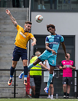 James Dobson of Slough Town & Sido Jombati of Wycombe Wanderers go up for the ball during the pre season friendly match between Slough Town and Wycombe Wanderers at Arbour Park Stadium, Slough, England on 8 July 2017. Photo by Andy Rowland.