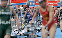 01 SEP 2007 - HAMBURG, GER - Andrea Whitcombe (GBR) puts on her bike helmet as she watches other competitors leave transition ahead of her - Elite Womens World Triathlon Championships. (PHOTO (C) NIGEL FARROW)