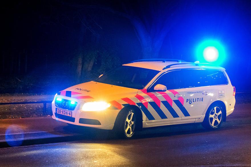 Nederland, Den Haag, 4 dec 2013<br /> Ongeval op de Bezuidenhoutseweg met een scooter.<br /> Er zijn gewonden, de politie is aanwezig met zwaailichten  <br /> Foto: (c) Michiel Wijnbergh