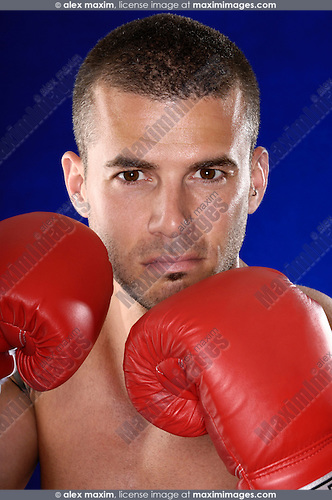 Expressive portrait of a kickboxer in boxing gloves