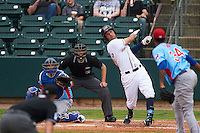 Montgomery Biscuits third baseman Patrick Leonard (20) at bat in front of catcher Kyle Schwarber and umpire Alex Ransom during a game against the Tennessee Smokies on May 25, 2015 at Riverwalk Stadium in Montgomery, Alabama.  Tennessee defeated Montgomery 6-3 as the game was called after eight innings due to rain.  (Mike Janes/Four Seam Images)
