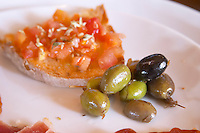 In the restaurant. Tomato on bread. Olives. Herdade da Malhadinha Nova, Alentejo, Portugal