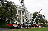 Construction cranes on the South Lawn of the White House looking towards the South Portico in Washington, DC is undergoing renovations while United States President Donald J. Trump is vacationing in Bedminster, New Jersey on Friday, August 11, 2017.<br /> CAP/MPI/CNP/RS<br /> &copy;RS/CNP/MPI/Capital Pictures