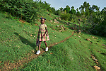 Chisland Selmond, 6, walks to school from her family's new home in Djondgon, a village near Jean-Rabel in northwestern Haiti. The family's previous house was destroyed during Hurricane Matthew in 2016, and Church World Service, a member of the ACT Alliance, helped the family build their sturdy new home.<br /> <br /> Parental consent obtained.