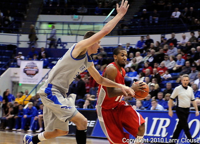 January 20, 2010: New Mexico guard, Nate Garth (11), drives the lane during the Lobos  Mountain West Conference match-up with Air Force at Clune Arena, U.S. Air Force Academy, Colorado Springs, Colorado.  New Mexico defeats Air Force 73-50.