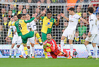 Swansea City Goalkeeper Lukasz Fabianski savs at the feet of Jonny Howson of Norwich City during the Barclays Premier League match between Norwich City and Swansea City played at Carrow Road, Norwich on November 7th 2015