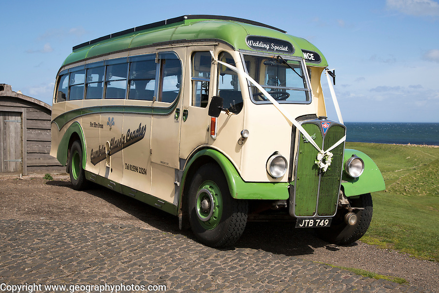 Antique motor coach seen on Holy Island, Lindisfarne, Northumberland, England, UK