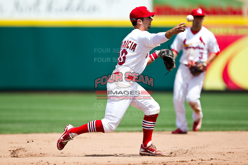 Greg Garcia (10) of the Springfield Cardinals throws to first base during a game against the Arkansas Travelers at Hammons Field on May 8, 2012 in Springfield, Missouri. (David Welker/ Four Seam Images).
