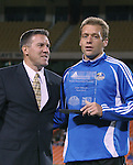 "27 October 2007: Kansas City Technical Director Peter Vermes (l) poses with team Defender of the Year Jimmy Conrad (r) who holds an award mistakenly reading ""Josh Wolff Team MVP"". The Kansas City Wizards defeated Club Deportivo Chivas USA 1-0 in the first leg of their Major League Soccer Western Conference Semifinal playoff series at Arrowhead Stadium in Kansas City, Missouri."