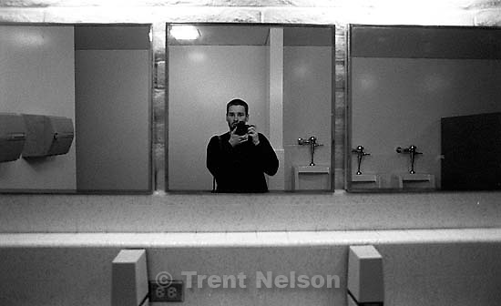 Trent Nelson in mirror with camera at rehearsal for the Miss Contra Costa County Pageant<br />