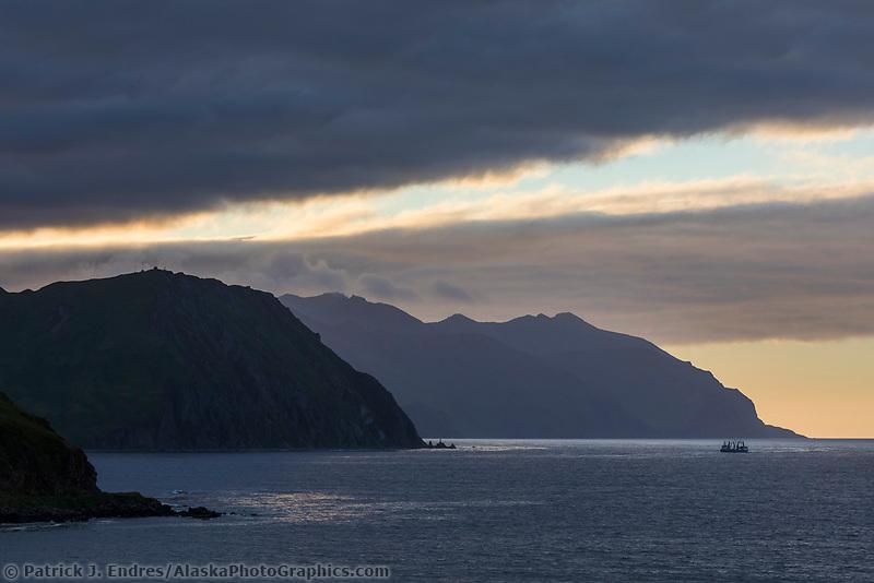 Ship exits the entrance way to Dutch Harbor International Port, Aleutian Islands, Alaska.