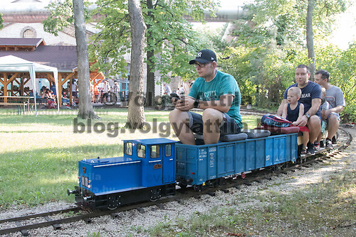 Visitors enjoy a ride in a garden railway during the European Garden Railway Convention held in Hungarian Railway Mueum in Budapest, Hungary on Aug. 18, 2018. ATTILA VOLGYI