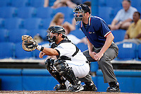 July 11, 2009:  Catcher C.J. Ebarb of the Dunedin Blue Jays and umpire Travis Carlson during a game at Dunedin Stadium in Dunedin, FL.  Dunedin is the Florida State League High-A affiliate of the Toronto Blue Jays.  Photo By Mike Janes/Four Seam Images