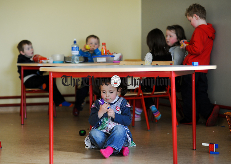 Little Leah Mc Namara in her own world at Carron National School. Photograph by John Kelly.
