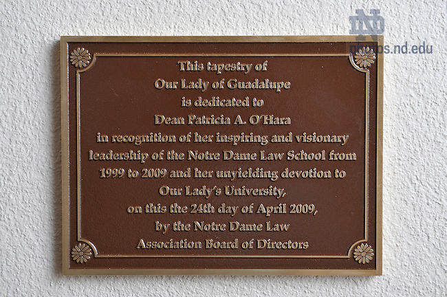 Dedication plaque for the tapestry of Our Lady of Guadalupe in recognition of Dean Patricia O'Hara in the Eck Hall of Law Chapel..Photo by Matt Cashore/University of Notre Dame