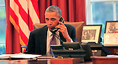 United States President Barack Obama participates in a conference call with state and local officials to discuss the Administration's domestic preparedness response to the Ebola epidemic in West Africa from the Oval Office of the White House in Washington, D.C. on Wednesday, October 8, 2014. <br /> Credit: Dennis Brack / Pool via CNP