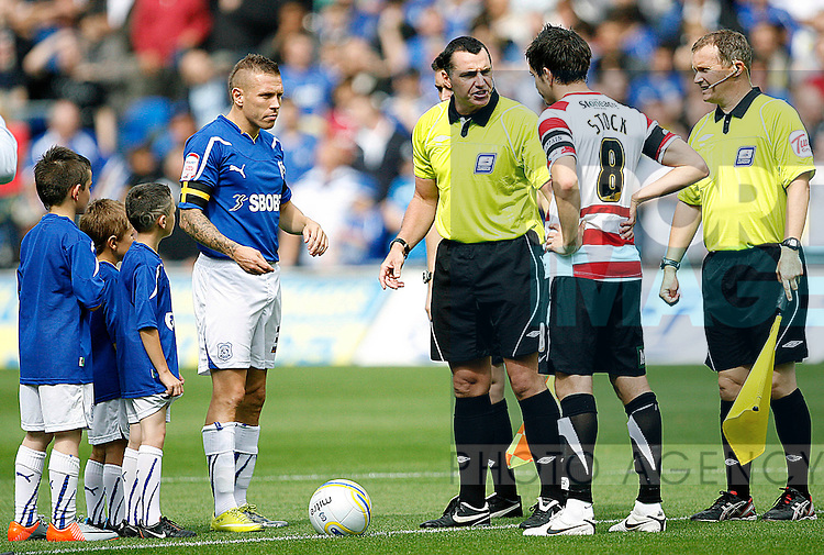 Craig Bellamy of Cardiff City tosses the coin for his team on his debut as captain