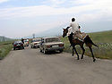 Armenia 2007 <br /> A Yezidi wedding in a village: the escort following the bride  on her way to the village of the bridegroom  <br /> Armenie 2007 <br /> Un mariage yezidi dans un village: l'escorte derriere la voiture de la mari&eacute;e allant au village du mari&eacute;