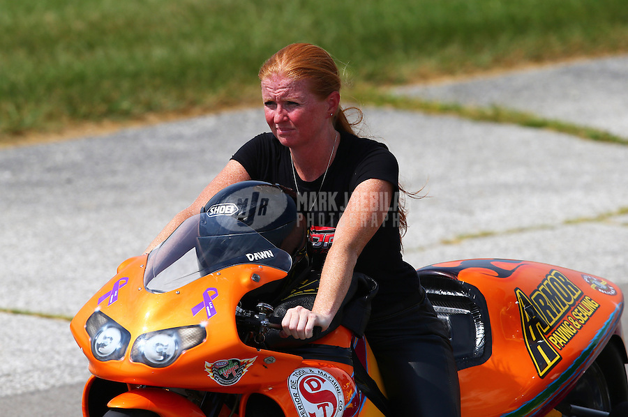 Aug. 31, 2013; Clermont, IN, USA: NHRA pro stock motorcycle rider Dawn Minturn during qualifying for the US Nationals at Lucas Oil Raceway. Mandatory Credit: Mark J. Rebilas-