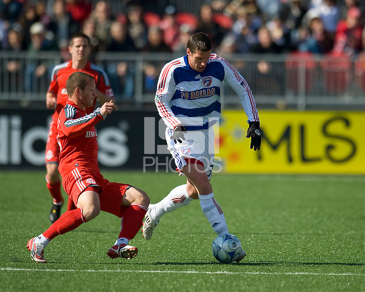11 April 2009:FC Dallas forward Kenny Cooper #33 and Toronto FC forward Chad Barrett # 19 battle for a ball during MLS action at BMO Field Toronto, in a game between FC Dallas and Toronto FC. .Final score was a 1-1 draw.