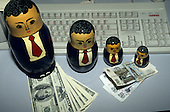 Moscow, Russia. Set of Babushka dolls (male) with Dollar and Rouble banknotes and a cyrillic computer keyboard.