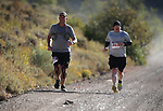 Half marathon runners, Jamie Cogley, left, and Erick Studenicka compete in the 8th annual Take it to the Lake race at Cave Lake State Park, near Ely, Nev., on Saturday, Sept. 21, 2019.<br /> Photo by Cathleen Allison/Nevada Momentum